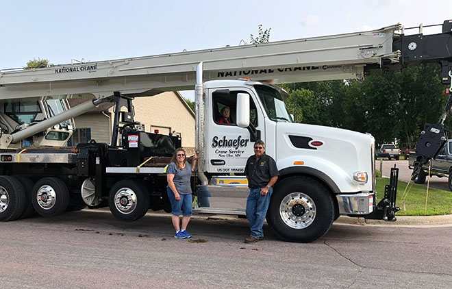 Schaefer Truck owners with a semi truck pulling a crane